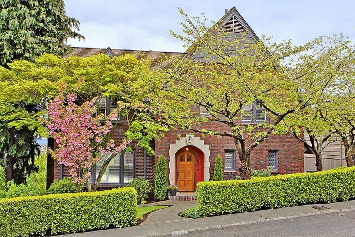 Tudor-style homes seem to have a little castle flair. This 1920 Tudor, atop Queen Anne at 3034 10th Ave. W., is especially so. The 3,810-square-foot house features arched doorways, curving stairways with wrought-iron railings, exposed-wood doors and moldings, coved ceilings, a basement workshop, steam heat and a manicured 6,550-square-foot lot. It has four bedrooms and 3.5 bathrooms, including a master suite with a walk-in closet and deck, and a lower-level guest suite. All this can be yours for $1.685 million.