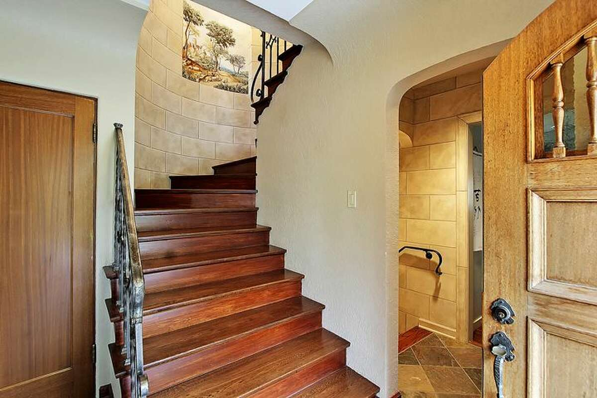 Entry of 3034 10th Ave. W.. The 3,810-square-foot house, built in 1920, has four bedrooms and 3.5 bathrooms -- including a master suite with a walk-in closet and deck, and a lower-level guest suite -- plus arched doorways, curving stairways with wrought-iron railings, exposed-wood doors and moldings, coved ceilings, a basement workshop, steam heat and a manicured 6,550-square-foot lot. It's listed for $1.685 million.