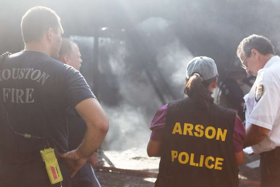 Investigators get the details of a fire that happened Friday morning in the 2800 block of Abernathy in Houston. No one was injured in the blaze, officials said. Photo: Johnny Hanson, Houston Chronicle