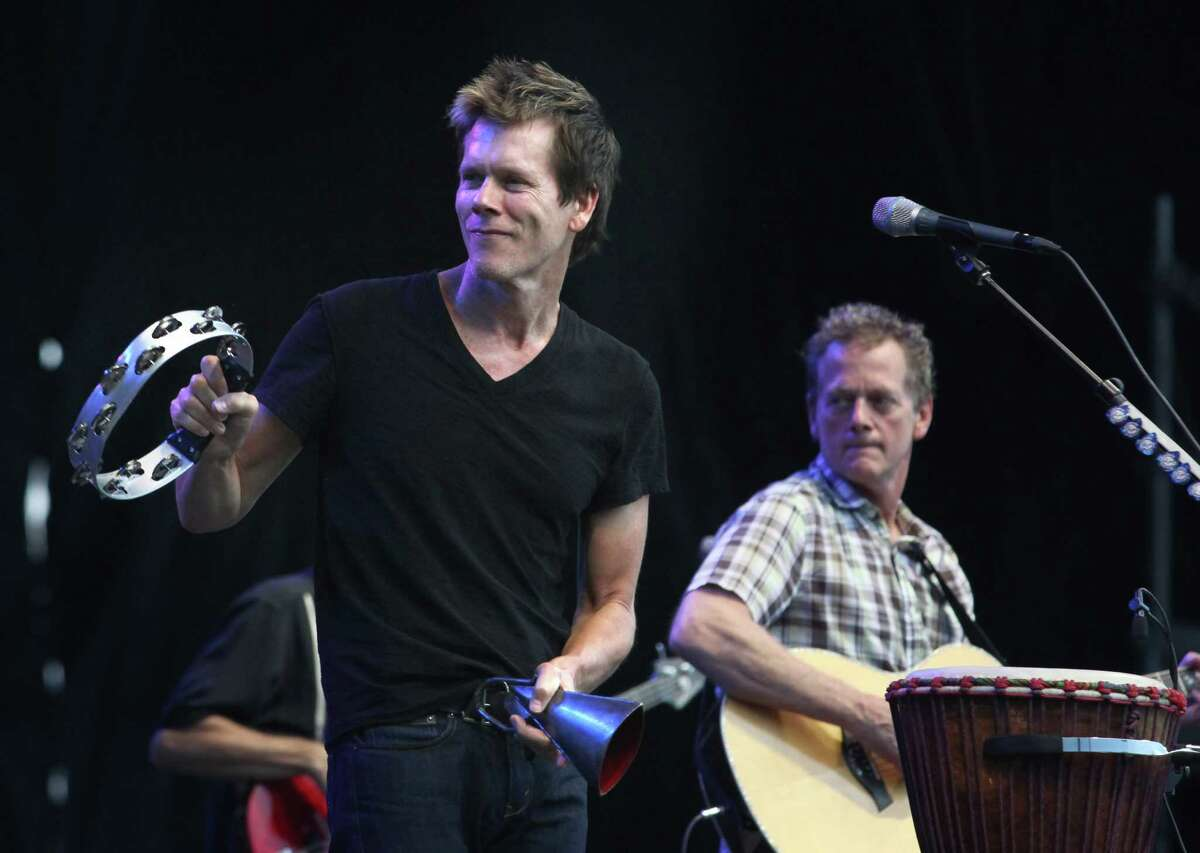Michael Bacon (right) and Kevin Bacon perform as the Bacon Brothers at the Cisco Ottawa Bluesfest on Thursday, July 8, 2010. The Ottawa Bluesfest is ranked as one of the most successful music events in North America. (The Canadian Press Images PHOTO/Ottawa Bluesfest/Patrick Doyle via AP Images)