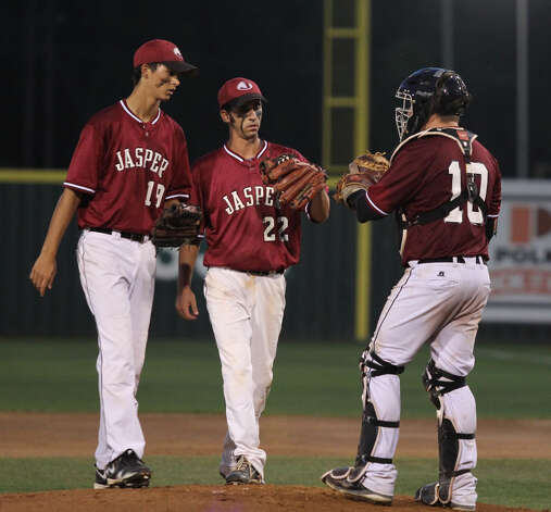 Jake Dufner, Tyler Bolton and Joe Walker confer on the mound. Photo: Jason Dunn