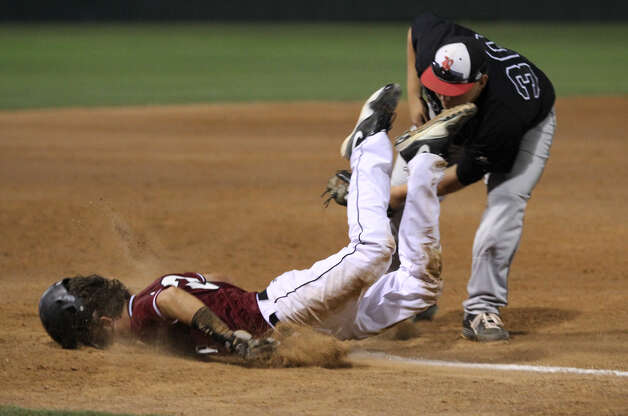 Jasper's Clayton Hart is tagged out while diving back to third base against Rusk. Photo: Jason Dunn