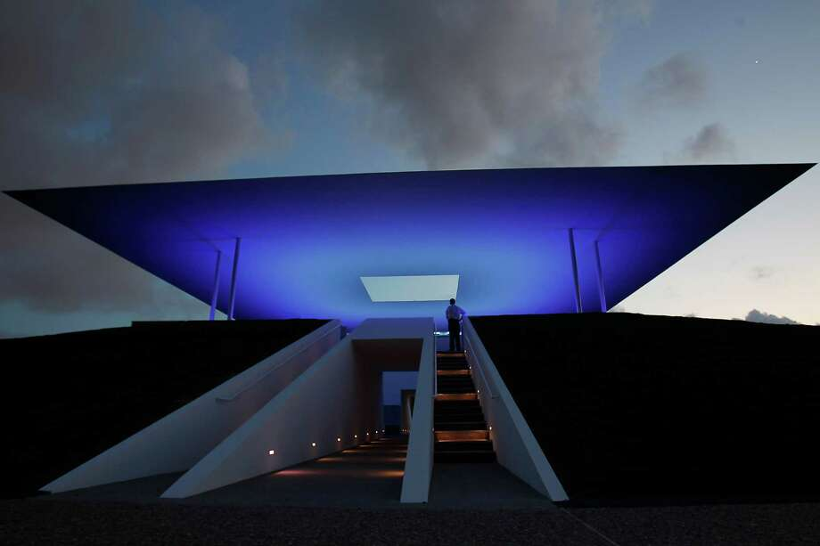 B.J. Almond, Senior Director of News and Media Relations for Rice stands under the new Skyspace by James Turrell at Rice University,Tuesday, May 1, 2012, in Houston. This is a huge outdoor sculpture that will become a major art destination in the U.S. A programmed light show will happen twice daily - at sunrise and sunset - when it officially opens in a few weeks. ( Karen Warren / Houston Chronicle ) Photo: Karen Warren / © 2012  Houston Chronicle