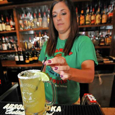 Bartender Jessica Graham at Starvin Marvin's on 11th Street makes  a Marvarita, which is a margarita made with one half oz. of St. Germain Liqueur, one half oz. of Grand Marnier Liqueur along with one and one half ounces of Patron Silver Tequila on April 24, 2012.   After adding the orange juice without the pulp to the mix, and the with Sweet and Sour, she then garnishes the glass with a lime and straw.  Dave Ryan/The Enterprise