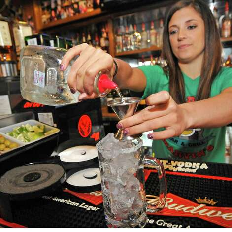 Bartender Jessica Graham at Starvin Marvin's on 11th Street makes  a Marvarita, which is a margarita made with one half oz. of St. Germain Liqueur, one half oz. of Grand Marnier Liqueur along with one and one half ounces of Patron Silver Tequila on April 24, 2012.   Dave Ryan/The Enterprise