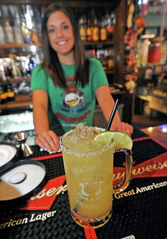 Bartender Jessica Graham at Starvin Marvin's on 11th Street makes  a Marvarita, which is a margarita made with one half oz. of St. Germain Liqueur, one half oz. of Grand Marnier Liqueur along with one and one half ounces of Patron Silver Tequila on April 24, 2012.   Dave Ryan/The Enterprise Photo: Dave Ryan