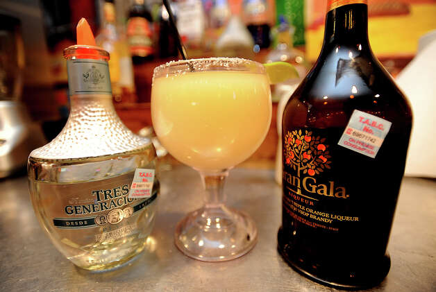Tres Generaciones and Gran Gala are used in making the 3-G Margarita at Cafe Del Rio in Beaumont, Wednesday,  April 25, 2012. Tammy McKinley/The Enterprise Photo: TAMMY MCKINLEY