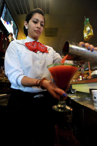 Yoriko Medina pours a strawberry margarita at La Cantina on Thursday. Thursday night is Margarita Madness at La Cantina. 4555 Dowlen Road in Beaumont. Photo taken Thursday, April 26, 2012 Guiseppe Barranco/The Enterprise Photo: Guiseppe Barranco, STAFF PHOTOGRAPHER / The Beaumont Enterprise