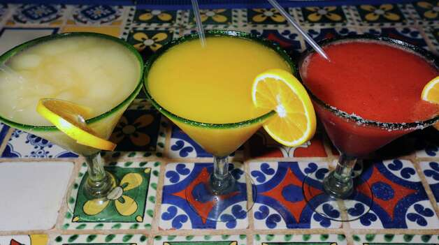 From left, The Gringo made with Don Julio 1942, mango margarita and a strawberry margarita at La Cantina. Thursday night is Margarita Madness at La Cantina. 4555 Dowlen Road in Beaumont. Photo taken Thursday, April 26, 2012 Guiseppe Barranco/The Enterprise Photo: Guiseppe Barranco, STAFF PHOTOGRAPHER / The Beaumont Enterprise