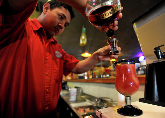 Martin Camacho pours a berry-berry margarita at La Cantina on Thursday. Thursday night is Margarita Madness at La Cantina. 4555 Dowlen Road in Beaumont. Photo taken Thursday, April 26, 2012 Guiseppe Barranco/The Enterprise Photo: Guiseppe Barranco, STAFF PHOTOGRAPHER / The Beaumont Enterprise