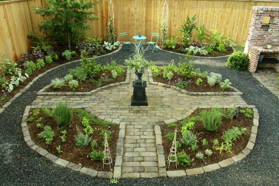 A Modified Four Square Herb Garden Is The Centerpiece Of The Back Garden At  The