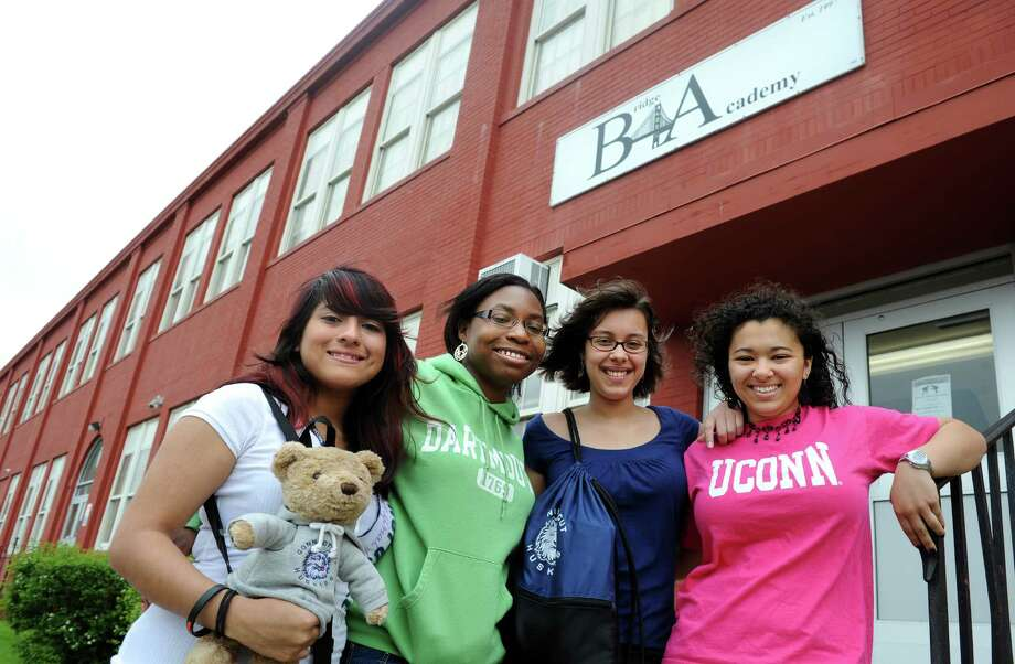 "Friends, Ruby Amigon, Shanet Hinds, Lais Lima and Karianna Montalvo, seniors at Bridge Academy Charter School, are known as the ""fab four.""  The four girls counted on each other to help themselves succeed.  Three plan to attend UConn and one, Shanet Hinds, is the first in the school's history to be accepted at an ivy league school, Dartmouth. Photo: Autumn Driscoll / Connecticut Post"