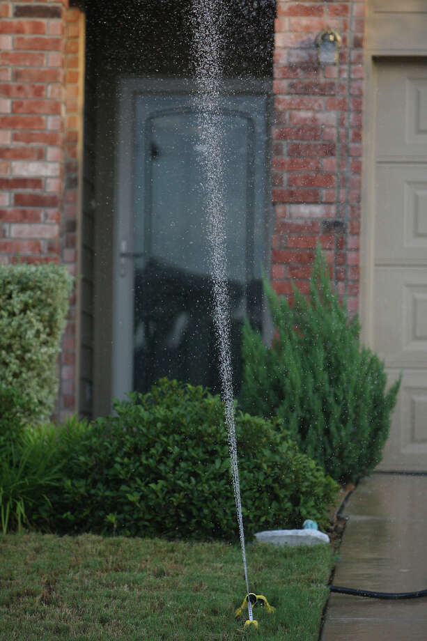 Stage 2 restrictions allow residents to water their lawns with sprinklers once a week on a designated day. Photo: EDWARD A. ORNELAS, Eaornelas@express-news.net / eaornelas@express-news.net