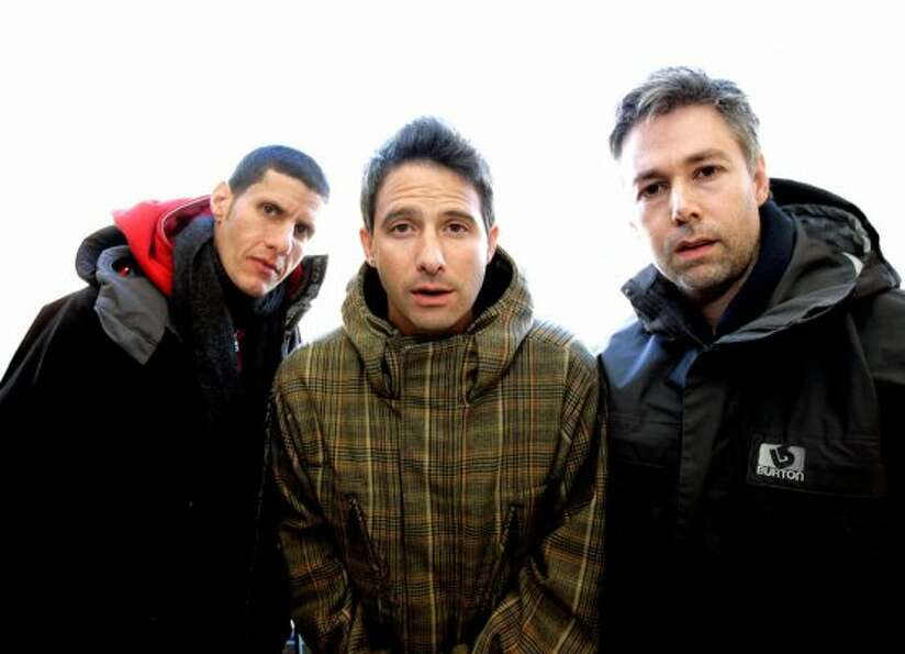 Mike Diamond, Adam Horowitz and Adam Yauch are photographed at the 2006 Sundance film festival, wher