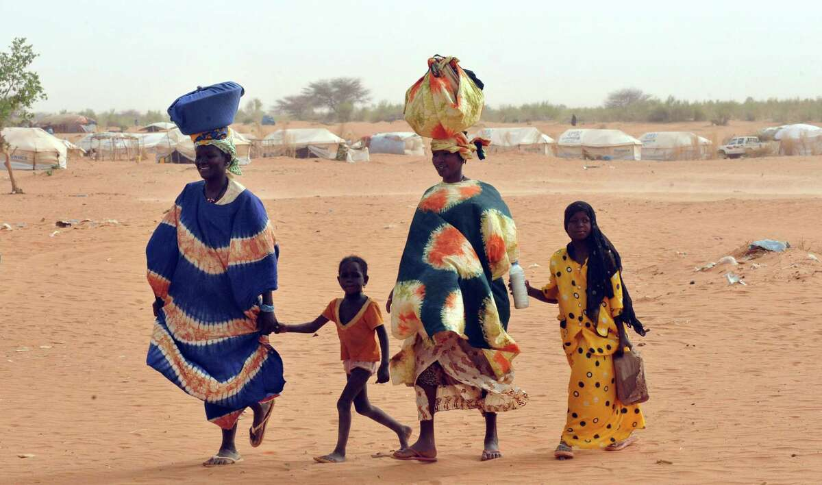 Malian refugees walk at Mbere refugee camp, near Bassiknou, southern Mauritania. (ABDELHAK SENNA/AFP/GettyImages)