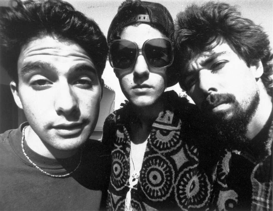 Adam Yauch of the Beastie Boys, right, died May 4, 2012, after a nearly three–year battle with cancer. He's shown here in 1989 – four years after he and the Beastie Boys first played in Seattle as the opener during Madonna's debut major-city concert tour. The Beastie Boys played several shows in Seattle, including a May 2007 gig at the Crocodile Cafe that sold out in minutes. Photos from that show follow. (AP/Capitol Records)