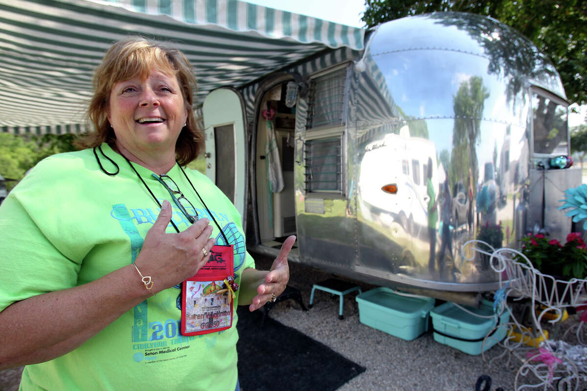 Karen Wigginton stands in front of her 1963 Airstream, which she calls