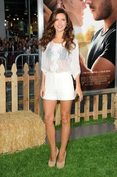 Another white sheer top over a black bra. Here's Audrina Patridge at 'The Lucky One' premiere on Apr