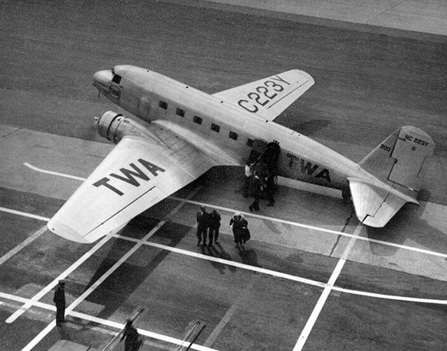 "Douglas Aircraft Co.'s first passenger airplane made its first flight 80 years ago, on July 1, 1933. Douglas developed the all-metal DC(Douglas Commercial)-1 to for TWA, to compete against the Model 247, which Boeing was building for then subsidiary United Air Lines.The DC-1 exceeded all of TWA's tough specifications except one -- it had two engines, rather than the three the airline wanted, according to a writeup by Boeing, Douglas' successor company.""The DC-1 was very advanced for its day,"" Boeing wrote. ""Its fuselage was streamlined, as were its wings and engine cowlings. It featured all-metal construction and retractable landing gear. Variable-pitch propellers gave the plane remarkable takeoff and landing characteristics. With plush seats, a kitchen and a comfortable restroom, the DC-1 set a new standard for passenger comfort.""Great efforts were made to insulate the passenger compartment from the noise of the plane's engines. The plane's passenger seats were mounted on rubber supports, while the cabin was lined with noise absorbing fabric. Carpet covered the cabin floor and even the engines were mounted on rubber insulators.""The DC-1 and could fly up to 180 mph and 1,000 miles, and reach 23,000 feet. In April 1935, it set a transcontinental speed record, flying from Los Angles, Calif., to New York in 11 hours and five minutes. It carried 12 passengers, two more than the Model 247.Douglas built just one DC-1, but ... Photo: San Diego Air And Space Museum"