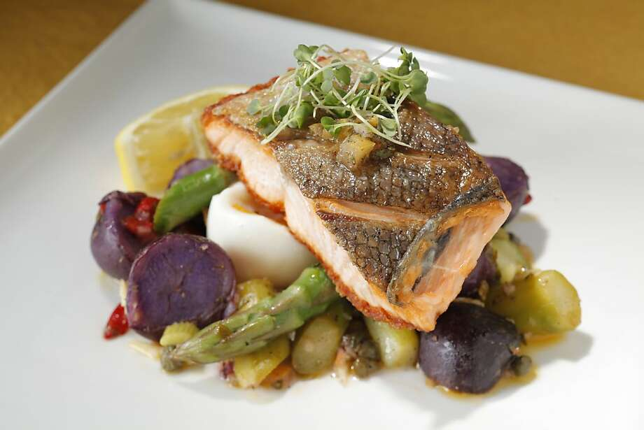 Sauteed Crispy Skinned Local King Salmon: A soft-cooked egg mixed with asparagus and potatoes make this a complete dish. Click here for the recipe.  Photo: Craig Lee, Special To The Chronicle