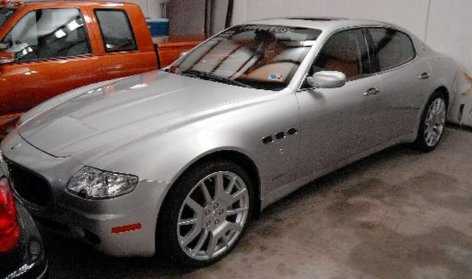 A 2006 Maserati belonging to reputed drug boss Raul Madrigal sits at a storage facility  (Houston Chronicle)