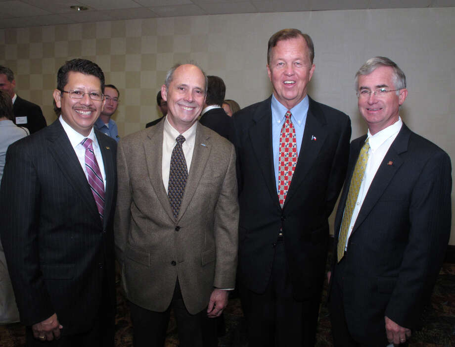 Greater San Antonio Chamber of Commerce President Richard Perez (from  left), member Klaus Weiswurm, former chamber President Joe Krier and  former chamber chairman Jim Goudge gather during the San Antonio Chamber  of Commerce Pathfinder Awards luncheon at the Marriott Rivercenter  Hotel Photo: Leland A. Outz, For The Express-News / SAN ANTONIO EXPRESS-NEWS