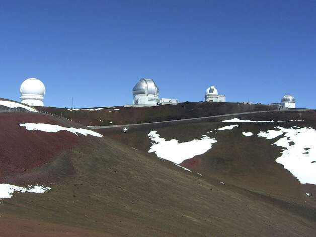 The dozen famous astronomical observatories atop Hawaii's Mauna Kea attract many visitors from around the world.  Photo: Forest M.  Mims III, For The Express-News