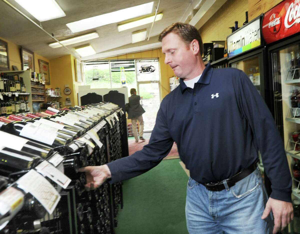John Freehill inside his Bruce Park Liquor store in Greenwich, Friday, May 4, 2012. Gov. Dannel P. Malloy is expected to sign a law allowing the sale of alcohol on Sundays, allowing liquor store owners such as Freehill to be open for business on that day.