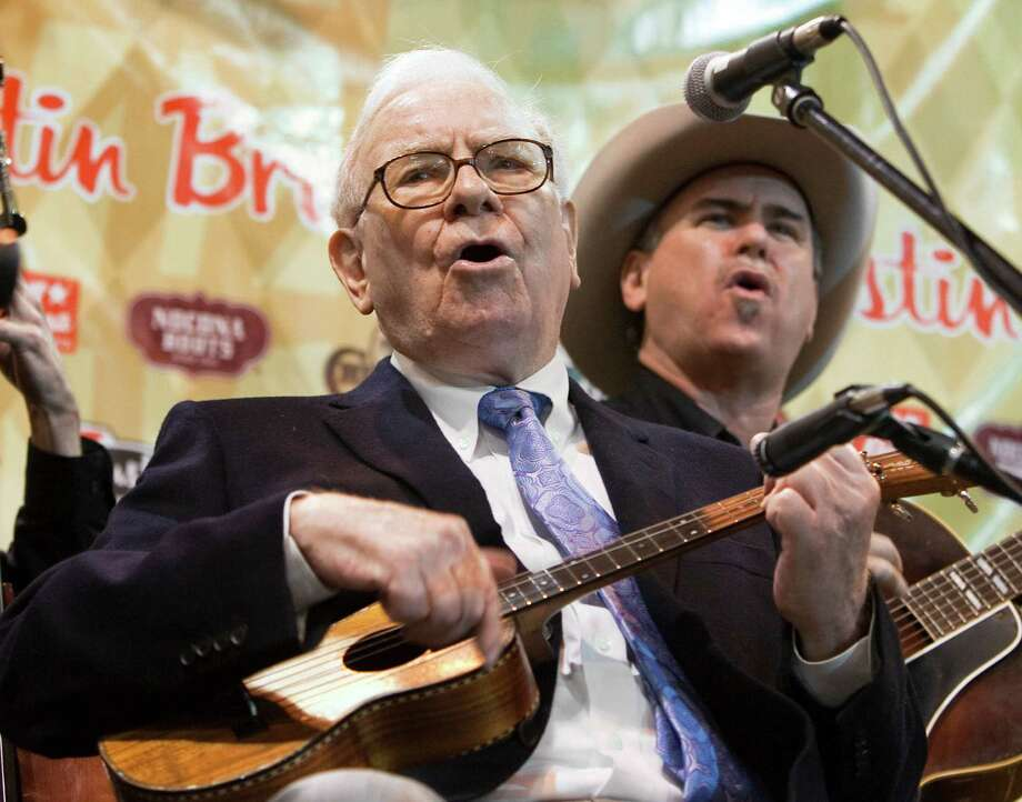 FILE - In this May 1 2010 file photo, Berkshire Hathaway Chairman and CEO Warren Buffett plays and sings with the Quebe Sisters Band during the annual shareholders meeting, in Omaha, Neb.  Buffett's recent prostate cancer diagnosis reminds Berkshire Hathaway shareholders that someday the 81 year-old will no longer run the conglomerate he built. Most shareholders would rather not imagine life without the Oracle of Omaha at the company's helm, especially when more than 30,000 of them are gathering in Omaha for this weekend's annual meeting. Photo: AP