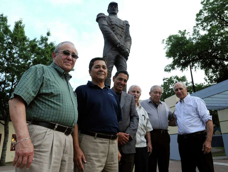 The runners of the Club Churubusco, Fernando Sanchez, left, Jorge Escobedo, Jesse Sandoz Jr., Pancho Gonzalez, Salvador Gamez and Robert Brischetto gather by the statue of Mexican Gen. Ignacio Zaragoza in Plaza Guadalupe on Thursday, May 3, 2012. Fifty years ago they helped celebrate the centennial of the 1862 Battle of Puebla, in which a Mexican army led by Gen. Zaragoza defeated a French army, by  running a relay from Goliad to the Mexican border, where a Mexican group of runners took their torch to Puebla.   Billy Calzada / San Antonio Express-News Photo: BILLY CALZADA, San Antonio Express-News / SAN ANTONIO EXPRESS-NEWS
