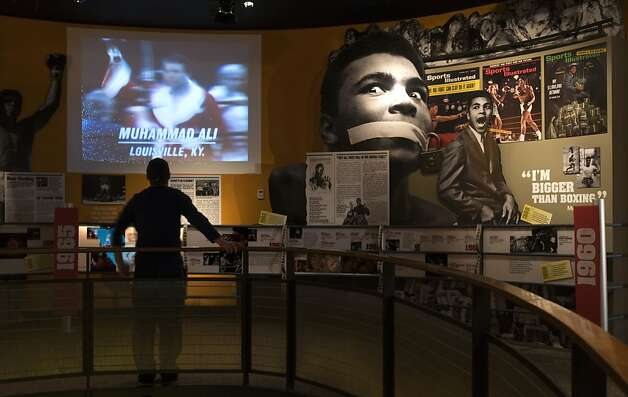 Ben Physick of Austrailia watches the life of Muhammad Ali in video clips on display at the Muhammad Ali Center in Louisville, Ky. Visitors to the Muhammad Ali Center see the three-time world heavyweight champion in his prime, railing against war and racial inequity and delivering knockout punches in the ring. They also see the softer side of a man embracing ideals of respect and spiritual growth. Although Louisville is best-known for the Derby, visitors in town for the May 5, 2012 race will find plenty of other things to do and see around town, from museums to historic hotels to trendy restaurants. (AP Photo/Brian Bohannon) Photo: Brian Bohannon, Associated Press