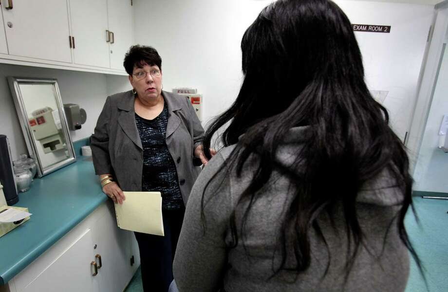 Nurse Sherry Hefner talks to a female student in an exam room in the Health Clinic at Roosevelt High School in Los Angeles, where students can get free condoms and get checked for sexually transmitted disease .  Bob Owen/San Antonio Express-News Photo: Bob Owen, San Antonio Express-News / © 2012 San Antonio Express-News