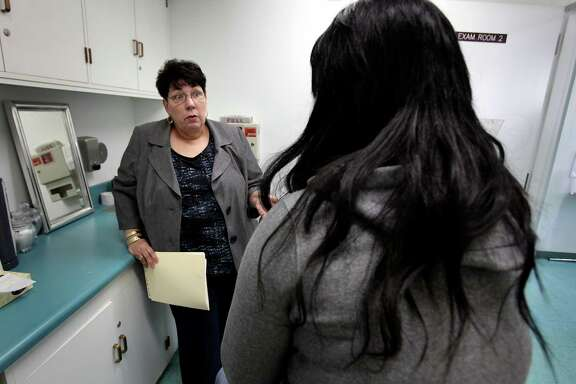 Nurse Sherry Hefner talks to a female student in an exam room in the Health Clinic at Roosevelt High School in Los Angeles, where students can get free condoms and get checked for sexually transmitted disease .  Bob Owen/San Antonio Express-News