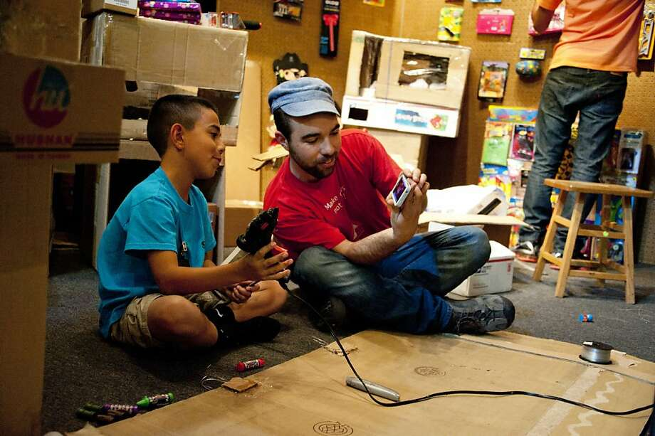 Caine Munroy, 9, was flown in from East Los Angeles with other makers at The Exploratorium in San Francisco, Calif., for an Open Make event.  Munroy is a low-tech maker who made an arcade out of cardboard boxes and tape. Photo: Amy Snyder, Exploratorium