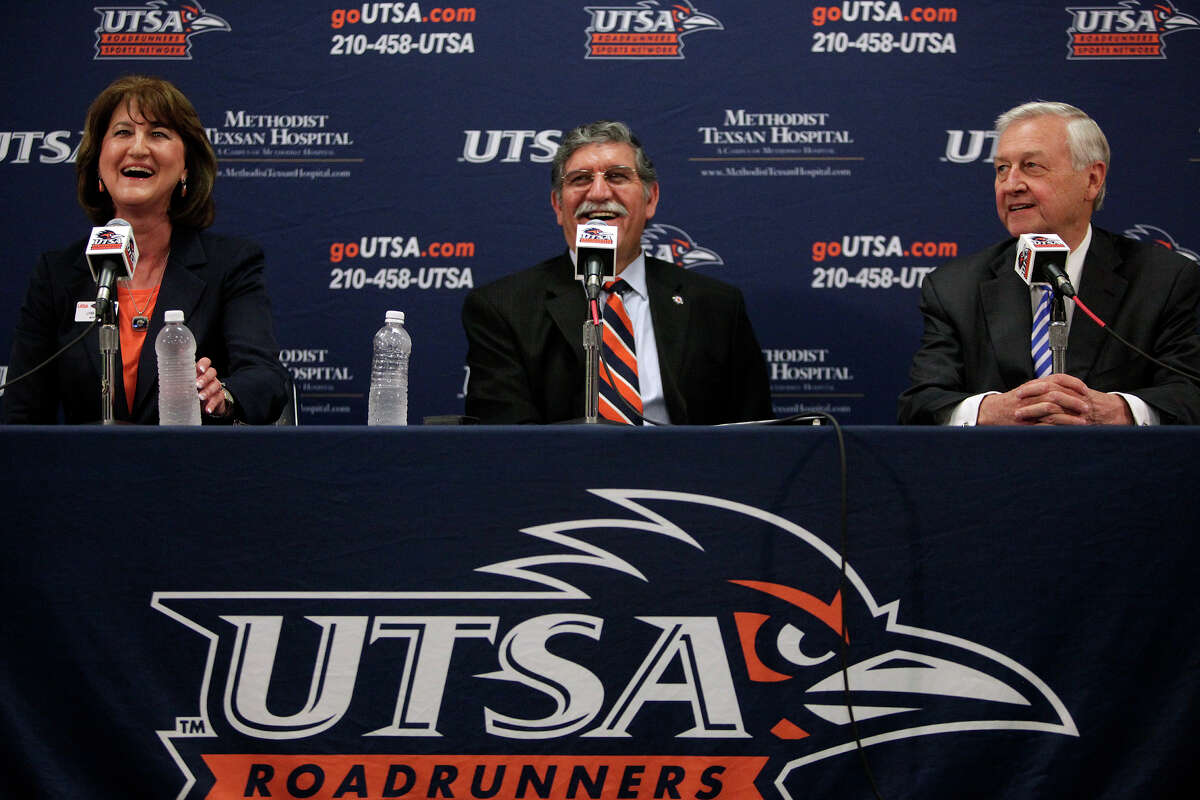 UTSA President Dr. Ricardo Romo, center, with athletic director Lynn Hickey, left, and Chairman of the Greater San Antonio Chamber of Commerce Football Task Force John Montford, right, announce the UTSA Roadrunners entry to Conference USA during a press conference at the university in San Antonio on Friday, May 4, 2012. Lisa Krantz/San Antonio Express-News