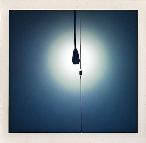 """Street Light"" - A street light is silhouetted by the sun at a random bus stop in San Francisco."