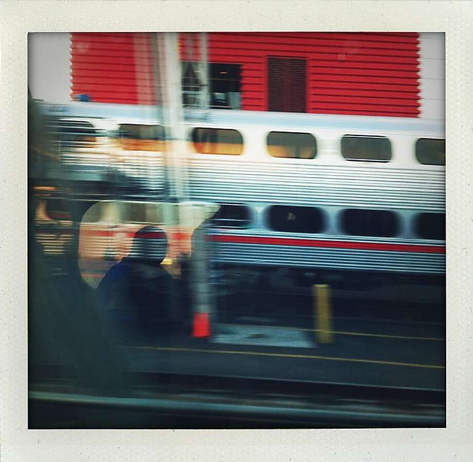 """Cal's Train"" - Reflection on a window while leaving the northern terminus of Caltrain, looking west. Photo: Meghan Gerzon Rand"