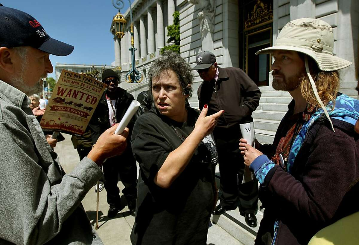 Mike Pincus, (left) and Stardust, (right) speak to auctioneers Terry Redmon, after she read a list of postponed foreclosures, none were auctioned off today, as members of Occupy Bernal pickets the foreclosure auctions daily on the steps of City Hall, on Friday May 4, 2012, in San Francisco, Ca.