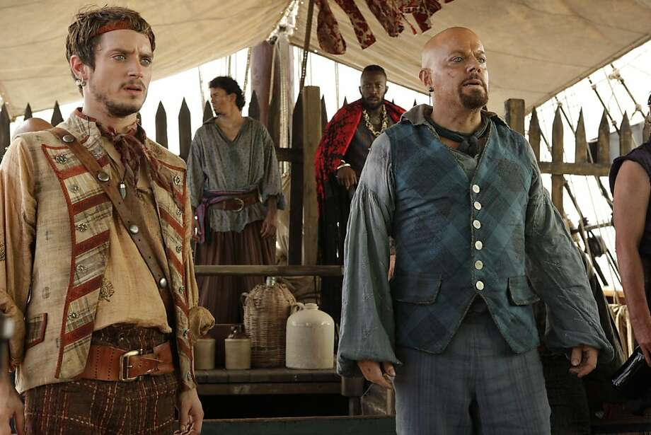 "TREASURE ISLAND -- ""Syfy Original Movie"" -- Pictured: (l-r) Elijah Wood as Ben Gunn, Eddie Izzard as Long John Photo: Syfy, NBCUniversal, Inc."
