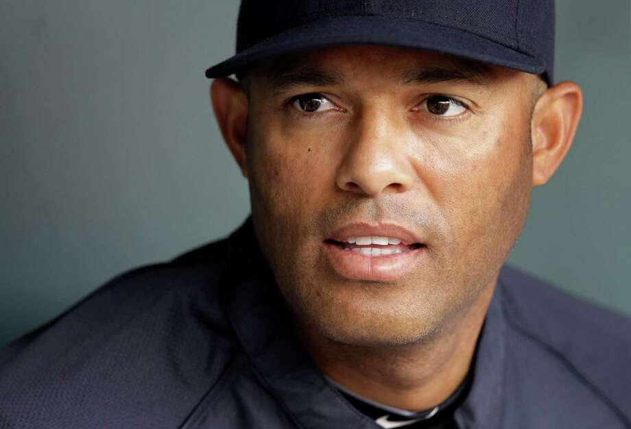 FILE - In this file photo taken April 9, 2012, New York Yankees' Mariano Rivera sits in the dugout before a baseball game against the Baltimore Orioles in Baltimore. The Yankees closer was carted off the field after twisting his right knee shagging fly balls during batting practice, Thursday, May 3, 2012, and was sent for further tests. Baseball's career saves leader was hurt before the Yankees played at Kansas City. Rivera was examined by Royals associate physician Dr. Joe Noland and Yankees trainers, and was set for an MRI at KU MedWest. (AP Photo/Patrick Semansky, file) Photo: Patrick Semansky / AP2012