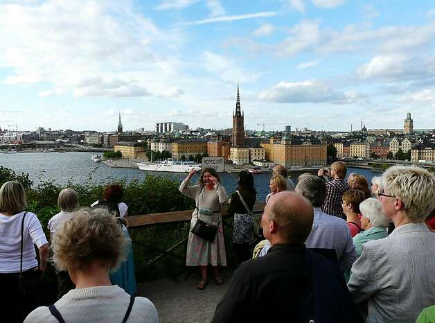 Piamaria Hallberg, guide for Stockholm's museum, conducts a guided tour of one and a half hours at Montelius on Sodermalm island in Stockholm, for fans of Millenium, the cult trilogy of Swedish author Stieg Larsson. Photo: Francis Kohn, AFP/Getty Images