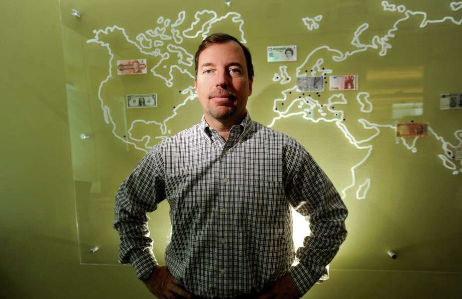 In this Nov. 24, 2010 photo, then PayPal president Scott Thompson, who in January 2012 was named CEO of Yahoo Inc., poses for photos at PayPal's offices in San Jose, Calif. Yahoo shareholder and New York hedge fund manager Daniel Loeb questioned Thompson's qualifications and integrity after exposing a misrepresentation about the executive's education. The fabrication confirmed by Yahoo Inc. on Thursday, May 3, 2012 gives Loeb more artillery as he tries to topple a board of directors favored by Thompson. (AP Photo/Noah Berger) Photo: Noah Berger