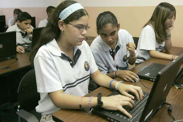 Students work on their laptop computers at Harmony Science Academy. Photo: Steve Campbell / Houston Chronicle