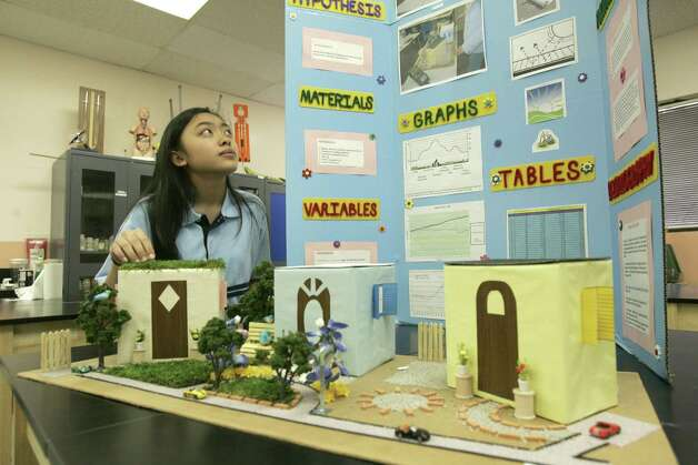 A student at Harmony Science Academy on South Braeswood looks over her science project. Charter schools like Harmony are a better choice for some students than the traditional public education system. Photo: Steve Campbell / Houston Chronicle