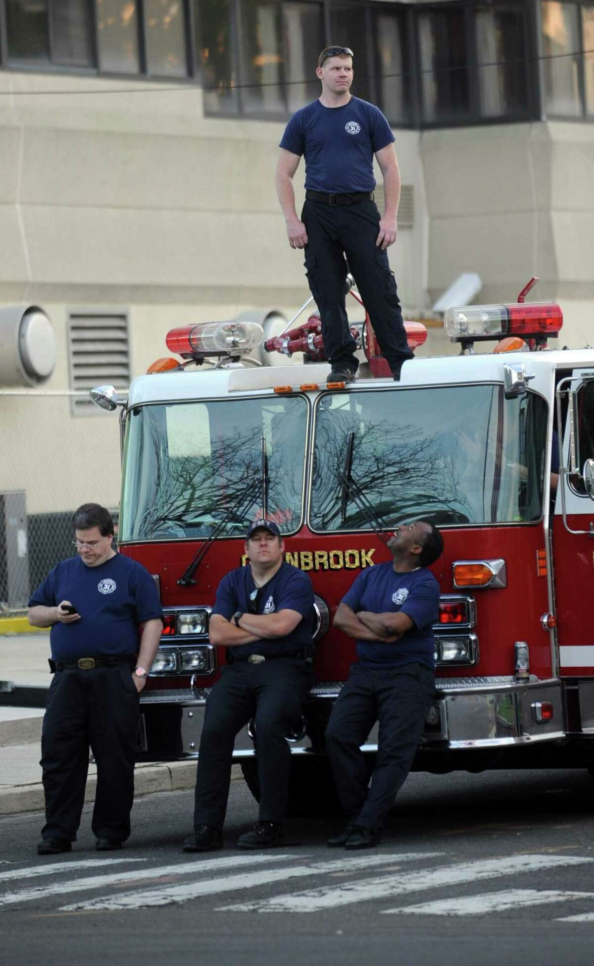 Members of the Glenbrook Fire Department watch the proceedings from their truck during the 6th annual Stamford Police Department Memorial Parade on Friday, May 4, 2012.
