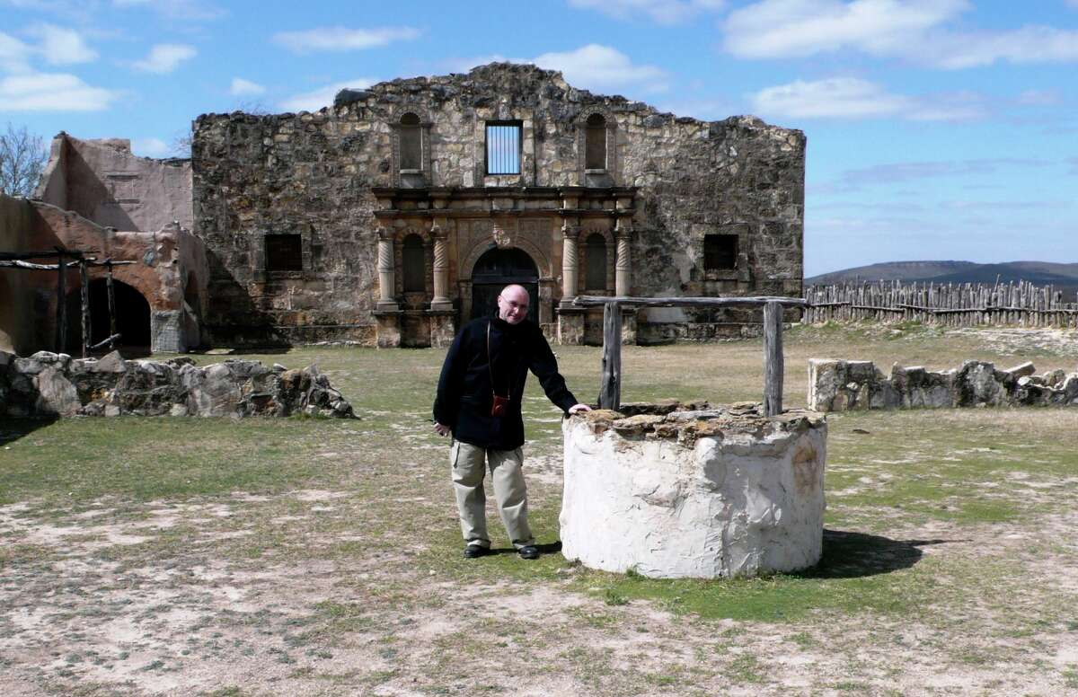"""Singer Phil Collins, shown on the set of John Wayne's """"The Alamo"""" in Brackettville last year, says there are always more sides to a story, even in Texas history."""