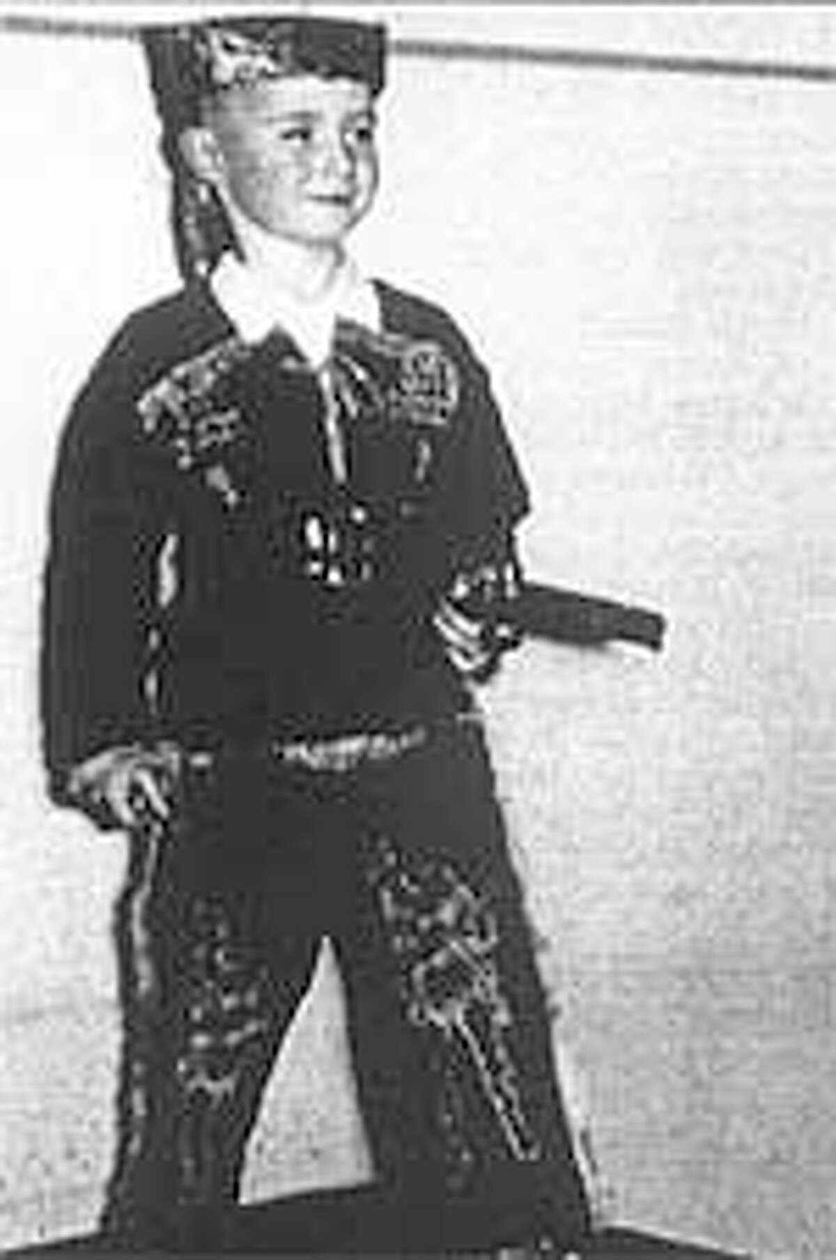 """Singer Phil Collins Alamo education began at an early age when he first saw Fess Parker in the """"Davy Crockett"""" TV series. Here he is at age 5 dressed up as Crockett."""