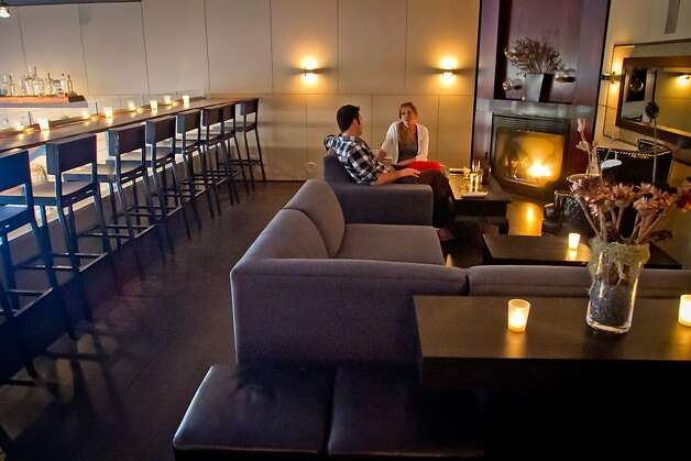 A couple enjoy a cocktail in the lounge in the mezzanine at Maven Restaurant in San Francisco, Calif., on Thursday, April 27th, 2012. Photo: John Storey
