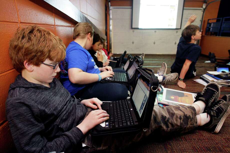 Jake Hausen, 11, works in his sixth-grade business class at Waukesha STEM Academy in Waukesha, Wis. Hausen and his classmates were doing a computer exercise related to baseball marketing for class. Photo: Angela Peterson / Milwaukee Journal Sentinel