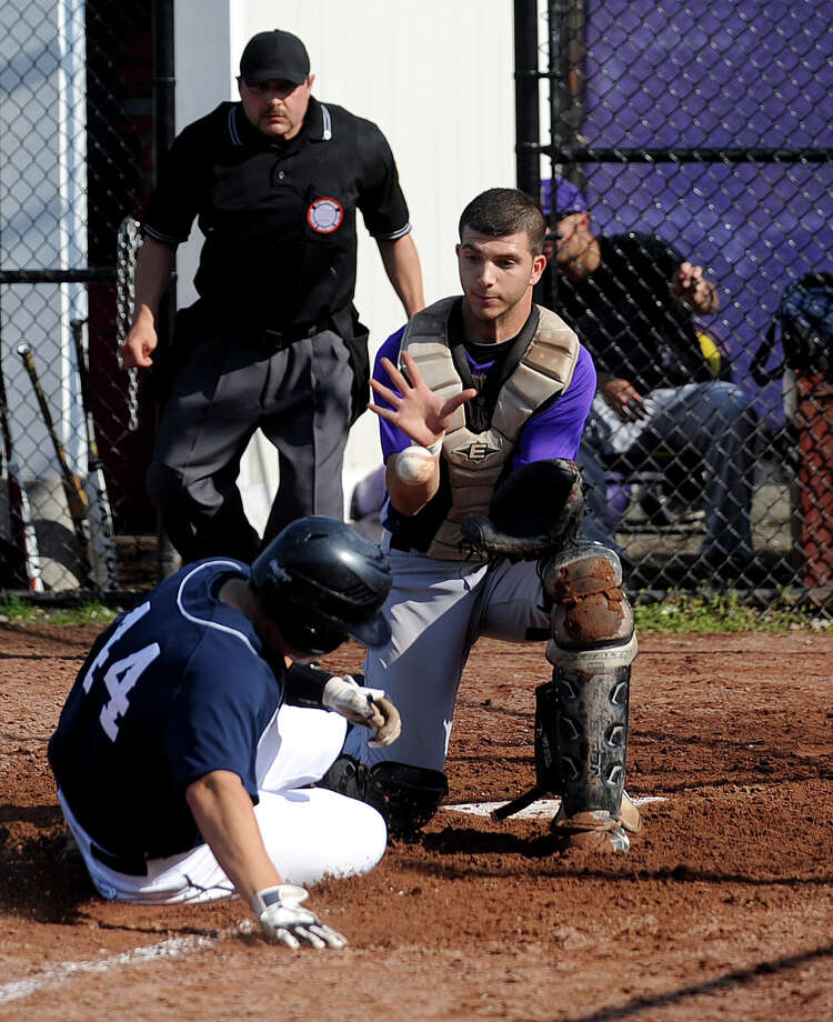 Staples' Bryan Terzian slides safely into home plate as Westhill catcher Josh Slutsky reaches for the ball during Friday's baseball game at Westhill High School on May 4, 2012. Photo: Lindsay Niegelberg / Stamford Advocate